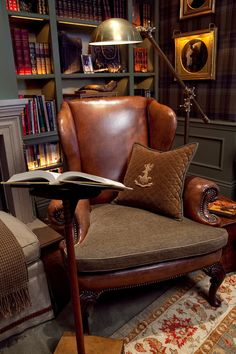 A leather chair, a bookcasefull of books and an awesome reading lamp. Scotch and Cigar anyone?