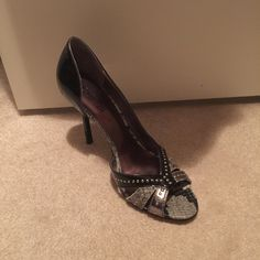 Guess heels Black and snakeskin Guess heels. Bought a few years ago but never worn. Cute open sides. Guess Shoes Heels