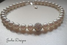 A personal favorite from my Etsy shop https://www.etsy.com/listing/128725795/swarovski-pearl-flower-girl-necklace