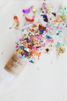These could be cute with your color scheme confetti and stuff! http://www.brit.co/diy-confetti-poppers/