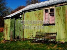 pics of tin homes | Green corrugated iron / tin house / shed with rusted metal bench stock ...