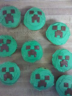 Minecraft Creeper cupcakes made with green frosting and rolled and cut Tootsie Rolls for boy's birthday.