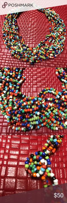 Vintage hand knotted beaded necklace Tribal choker length necklace. Hand knotted beads in multi strands by Native Americans in Oklahoma! My mother bought this back in the fifties, so I know it's at least 70 years old. Worn very little, and in perfect condition. Gorgeous worn anytime of the year. Not heavy. Jewelry Necklaces
