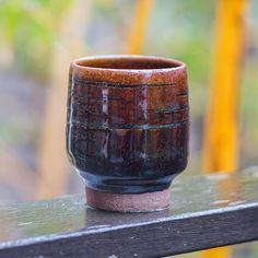 This toffee tenmoku yunomi is one of 20 pieces (some already sold) currently showing in the 'High Tea' exhibition at the Porthminster Gallery St Ives. The glaze pools and runs in the heat of the kiln picking up details and marks that were made in the fresh clay for this purpose. If you're in St Ives see it @porthminstergallery . . . . . #yunomi #tea #vessel #turned #toffee #tenmoku #glaze #pottery #clay #stoneware #ceramics #craft #handmade #making #handcrafted #ceramic #maker #artisan…