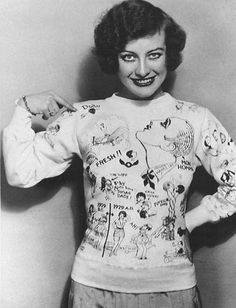 "Joan Crawford in a hand drawn, hand lettered jersey in 1928. Note the arrow pointing to the large profile of Douglas Fairbanks, Jr. It indicates ""Mon Homme,"" my man."