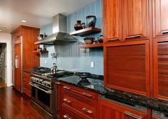 blue kitchen walls cherry cabinets | Beautiful Kitchen Cabinets We Loved | Home Remodel Blog | Case Design ...