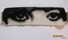 "Loomed beaded ""watching you"" 3D cuff"