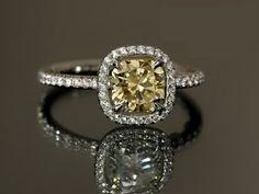 Future husband take note! Cushion cut fancy light yellow diamond with a diamond band <3
