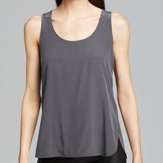 Vince Gray Viscose Tank Shirttail slate Large NWT Vince Tank-Shirttail.  This low key turned luxe Vince tank is refreshingly modern with a rounded shirttail hem and breezy, boxy fit.  Scoop neck, sleeveless, rounded high/low hem with side vents.  Viscose; contrast: silk Large NWT Vince Tops Tank Tops