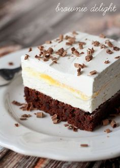 Brownie Delight - a delicious 4-layer dessert that is cool, creamy and chocolate-y.  I love desserts that I can make homemade whipped cream for..yum!