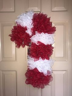 Would it be acceptable to have 30 Christmas wreaths? I want all of these beauties, I could have 1 each day from Thanksgiving to Christmas. Candy Cane Crafts, Candy Cane Wreath, Candy Canes, Holiday Wreaths, Holiday Crafts, Christmas Decorations, Winter Wreaths, Spring Wreaths, Summer Wreath