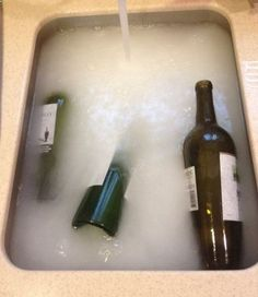 Fill your sink with hot, hot, hot water. Then fill each wine bottle with hot water and drop it into the sink. Next, add this secret potion: 1/2 cup baking powder 1 Tbsp dish soap 2 cups white vinegar Once you add the vinegar to the sink, it will get all fizzy for a second. And the labels come off. #props