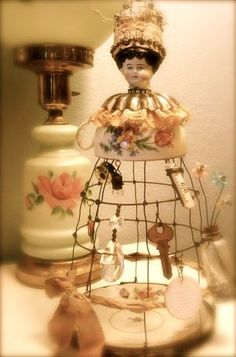 Found objects wire doll..have the wire, have the cup, probably have the head..make it!
