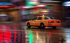 Urban Photography Idea: Pan Shot in the City - Yellow Cab in the Rain by Brandonjpro