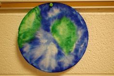 make planet earth from a coffee filter--color with markers and spray with water