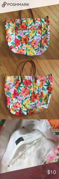H&M Floral Tote Pink and Yellow Floral Beach Tote. Some minor stains/discoloration on inside just from use...the interior is also white so it was difficult not to stain! But nothing major. Cute little bag for the beach or summer activities. H&M Bags Shoulder Bags