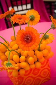 gerbera daisies and kumquats, glorious orange