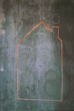 The kitchen Concrete surfaces provide space for chalk drawings. PHOTOGRAPHY NATHALIE KRAG