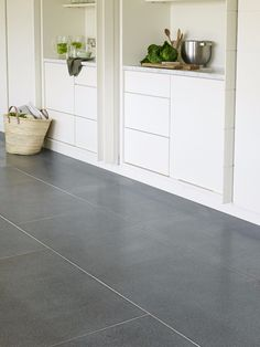 Zeus Honed Granite flooring provides a striking contrast against this simple white kitchen. Limestone Flooring, Granite Flooring, Natural Stone Flooring, Kitchen Flooring, Kitchen Built Ins, Mandarin Stone, Clever Kitchen Storage, Kitchen Gallery, Tiles Texture