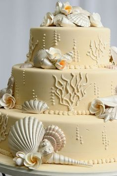 Gorgeous color on this beach wedding cake! More inspiration at diyweddingsmag.com