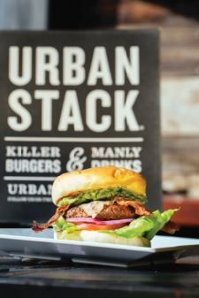 Urban Stack Avocado Burger. Certified Angus Beef with made-from-scratch guacamole, bacon, farm fiesta cheese, tomato, red onion, and chipotle aioli sauce. Photo by Lanewood Studio.