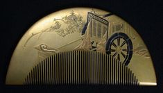 An Edo lacquered wood and gilt embossed comb with Takamaki-e (a technique where the lacquer is polished down to show the gold paint in high relief) shows a palanquin highlighted in black.