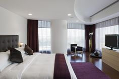 Modest Apartment Bedroom Modern Use Modern Furniture With Purple Carpet And Red Curtains Stylish Apartment Bedroom Design to Comfort Your Living Apartment Bedroom Setup, Apartment Bedroom Decor, Cozy Apartment, Apartment Interior, Apartment Design, Bedroom Tv, Bedroom Themes, Apartment Ideas, Bedroom Ideas