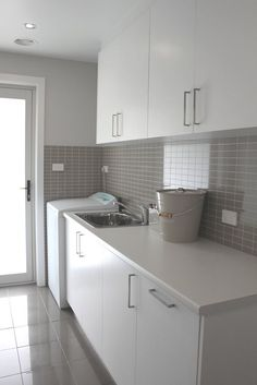 Explore laundry room decorating ideas that are both stylish and functional. From extra storage space and hidden appliances to pops of color and reclaimed wood, these laundry rooms will inspire your next home renovation project. Laundry Nook, Laundry Decor, Laundry Room Cabinets, Laundry Room Organization, Laundry In Bathroom, Laundry Storage, Organization Ideas, Modern Laundry Rooms, Laundry Room Inspiration