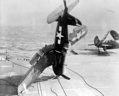 Emergency landing of American carrier-based fighter Chance Vought F4U Corsair on the deck of an aircraft carrier.