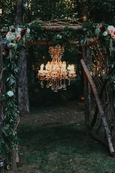 Outdoor Ceremony Wooden Floral Arch Multicoloured Flowers Greenery Chandelier Bohemian & Whimsical Garden Wedding in North Carolina http://www.taylorparkerphotography.com/