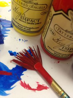 Tattered Angels High Impact Paint can get applied with your favorite brush.  It is water-based and washed out easily.