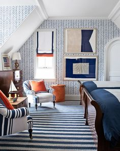 Plain white ceiling, but chevron walls (where not white) and striped floors) in blue and white with wood and orange accents. Can we get a carpet in that stripe?