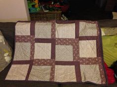 Handmade lap quilt in shades of purple