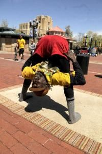 Boulder Pearl Street Mall performer 'Ibashi-i' stretching before the show