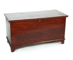 "Garths | Lot 664 AMERICAN GRAIN PAINTED BLANKET CHEST.  Ca 1840-60, poplar. Red decoration with a yellow ground. Dovetailed case and mitred feet, walnut interior til. Molded lid and a replaced brass keyhole. 23.5""h. 44.25""w. 20.25""d  Estimate $ 250-400"
