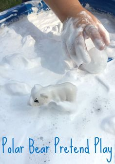 Snowy play year round! Quick small world pretend play set up - Polar bear and arctic sensory play idea!