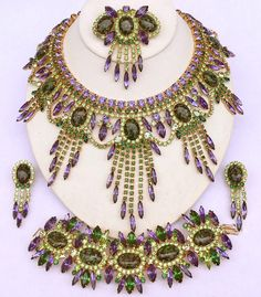 Purple Rain 2008  DiMartino Originals is the signature of a Tennessee artist who has been making jewelry for more than 20 years. She taught herself the almost-lost art of costume jewelry making; combining it with her copious artistic talent, she has created some of the most beautiful rhinestone jewelry. She uses primarily Swarovski Austrian crystal rhinestones, vintage and hand-painted cabochons, many of which are no longer being made.