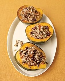 Wild Rice-Stuffed Squash Stuffed acorn squash halves make a picturesque presentation at the table. The filling of wild rice, dried cherries, and pecans is substantial enough to serve this as a vegetarian main dish. Get the Wild Rice-Stuffed Squash Recipe Thanksgiving Side Dishes, Thanksgiving Recipes, Fall Recipes, Thanksgiving Feast, Vegetarian Thanksgiving, Holiday Recipes, Vegetarian Recipes, Cooking Recipes, Cooking Tips