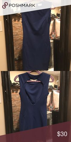 Sleeveless bodycon dress Royal blue Tobi sleeveless bodycon dress with crew neck, cutout at back, button fixtures at nape of neck and zip closure at center back. Tobi Dresses Mini