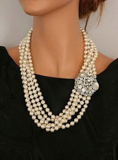 Dramatic clasp on multi-row pearl necklace, loose and ladylike at the same time