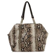 """Este bolso de mano pertenece a la colección """"Atardecer en África"""" de la firma D´dona. De este bolso nos encanta su estampado animal print"""