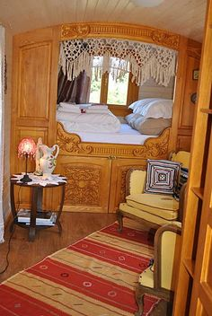 cozy bed area, with beautful wooden trim. Also has nice setting area (reading nook) Has storage under bed too! Perfect!
