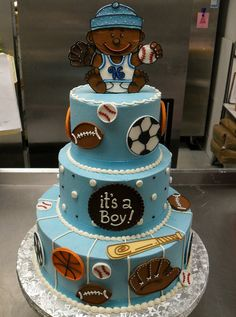 sports theme baby shower cake. Love this idea for girls & have the cake pink instead.
