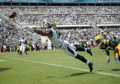Jacksonville Jaguars wide receiver Allen Robinson, left, dives for a catch in front of Green Bay Packers cornerback Sam Shields, right, during the first half of an NFL football game in Jacksonville, Fla., Sunday, Sept. 11, 2016.