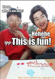 Siwon painting a kids face. Lol!!!! The boy's expression is so funny!!!
