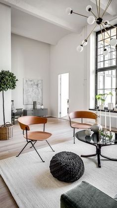 Mid-century modern minimalism. Who knew the fifties could feel like tomorrow? Branding itself with beautiful chairs and a Sputnik chandelier, this piece takes a futuristic look at the past.