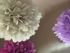 DIY Pom Poms. Gonna hang from the ceiling in the girl's room!