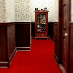 """""""Hiding Attic""""   Miniature hallway designed, built, and photographed by Harvey Brand Imagery."""