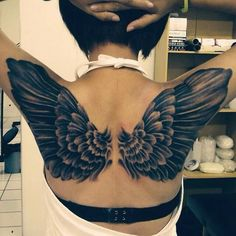 I usually don't like wing tattoos, but I have to say this one is pretty cool.. and very pretty