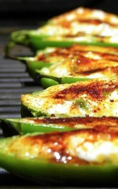 Here's something new to try out on your grill!  Slice some large jalapenos in half.  Fill the halves with cream and cheddar cheeses, a little green onion, and garlic.    Get creative if you want, and add finely chopped tomato or crumbled bacon.  Throw them on the grill until the skin is roasted and the cheese is bubbly and brown.  Serve hot.  Bon appetit!